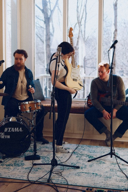Eva Cassel and band rehears before filming a music video