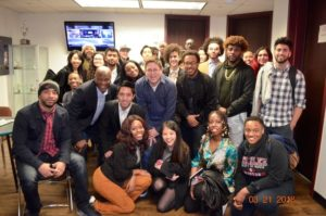 Students pose for a photo at Atlanta radio station V-103