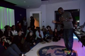 Students listen to Leslie Brathwaite speak from his personal studio