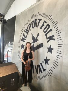 Louisa poses in front of the Newport Folk main stage sign