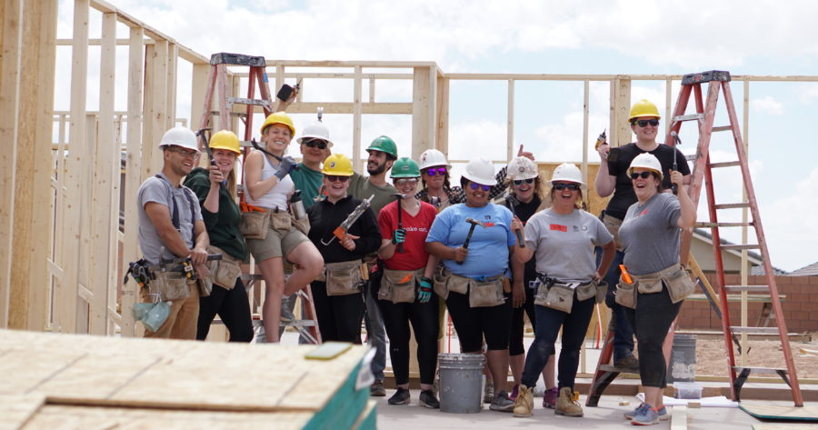 Gracenotes 2019 crew poses in the house frame they helped build