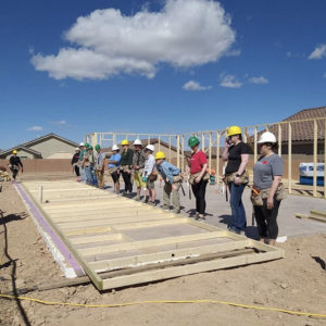 The Gracenotes crew prepares to lift a wall frame
