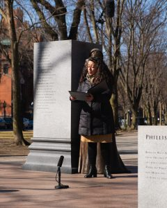 Carrie Cheron singing for the Women's History Month event in Boston