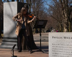 Francine Trester playing violin in Boston for Women's History Month